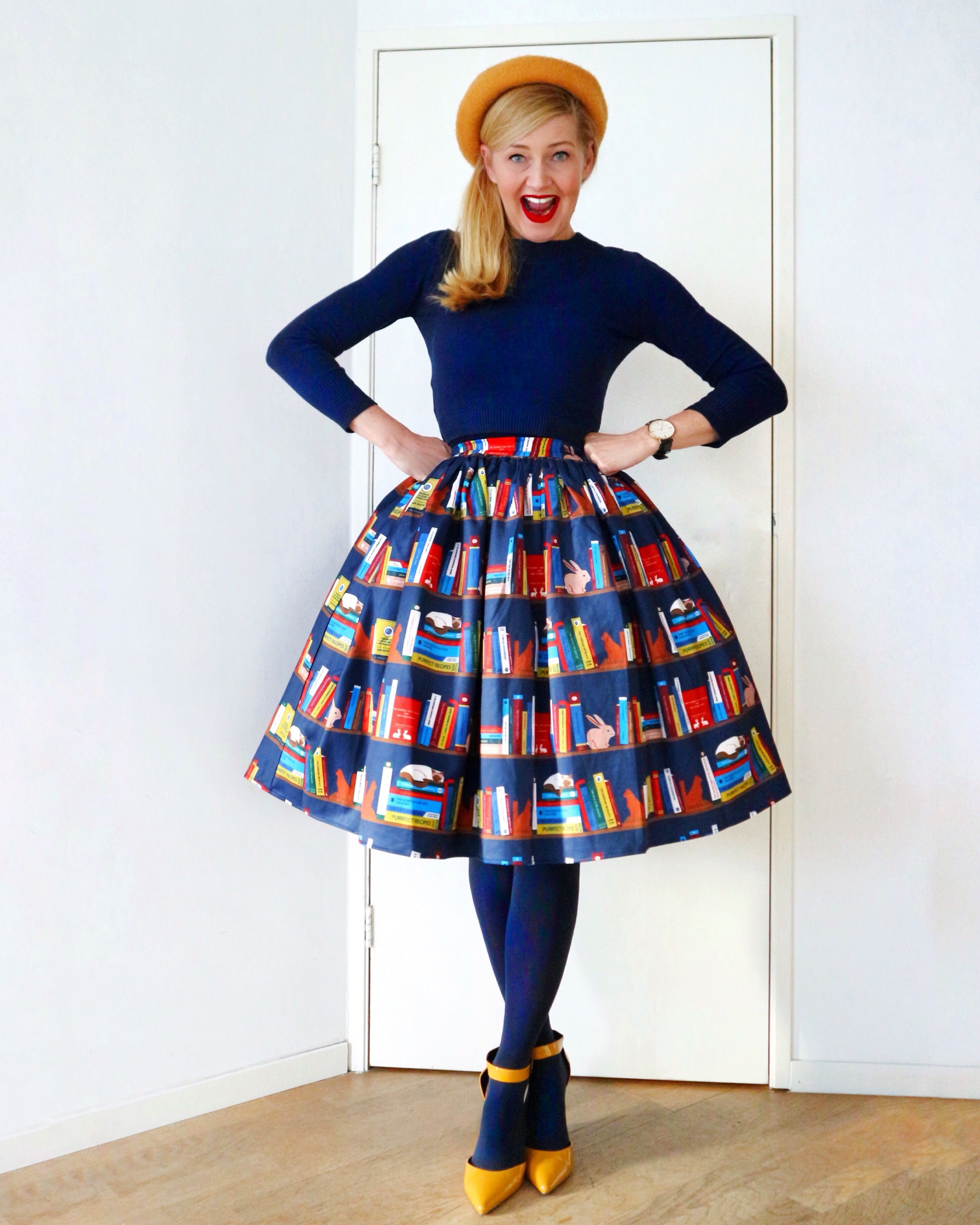 9aadc2832748 We're loving her Jasmine book shelf swing skirt paired with our Tracy  jumper! #collectifclothing #librarianchic #vintage #library #printedskirt