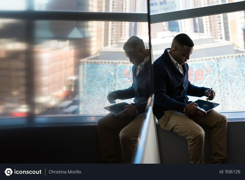 Free Man Sitting Beside Window Photo download in PNG & JPG