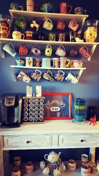 Welcome to Central Perk! Here's a bright and colorful coffee bar with a Disney mug collection for fun. #disneykitchen