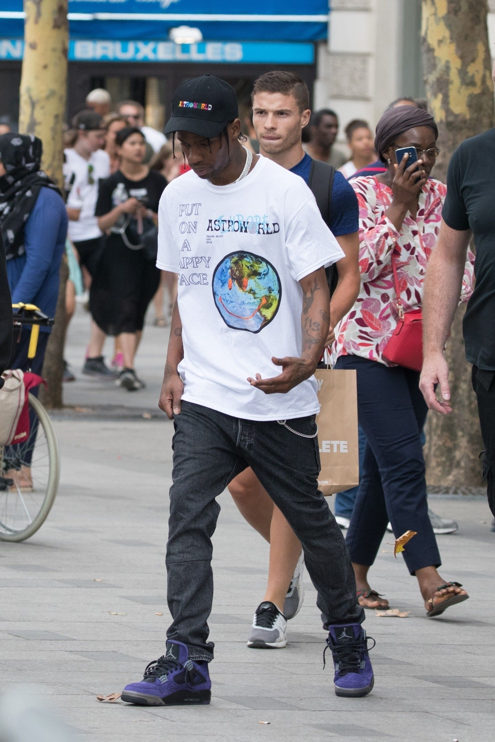 b24d68642ab5f4 Travis Scott wearing Fan Merchandise Hats