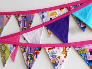 handmade flag bunting  with superhero fabric - including ones with wonder woman + bat girl! | spry sprout