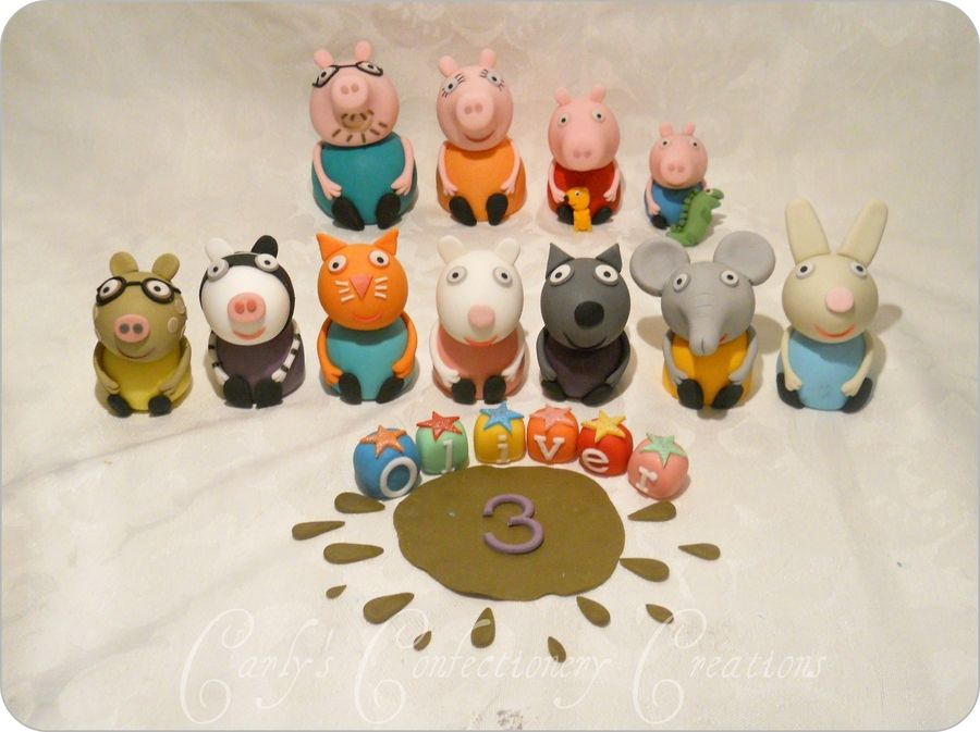Edible handcrafted peppa pig family friends cake