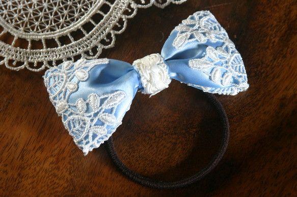 ブルーのリボンの飾りのヘアゴムです。|ハンドメイド、手作り、手仕事品の通販・販売・購入ならCreema。