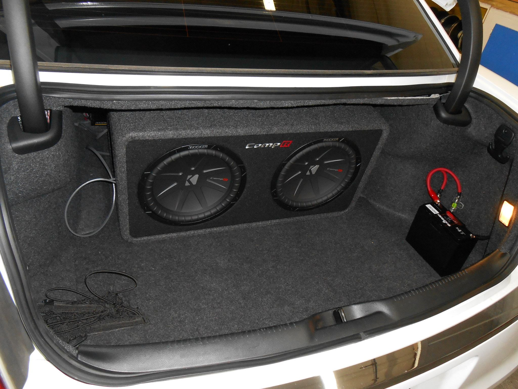 2 Comp R Subwoofer Hooked Up To A 1200 Watt Kicker Amp And