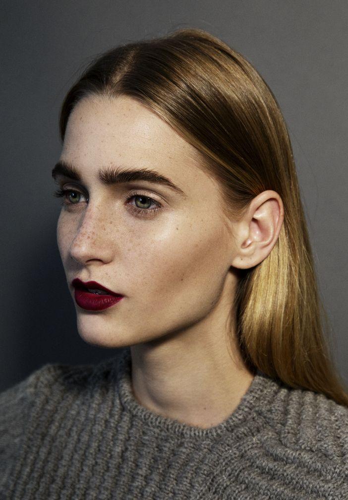 Dark eyebrows and burgundy lips.