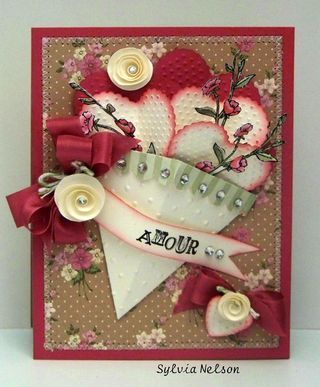 City Crafters Challenge Blog.  Card has many elements: nice color, stamped and cut flower, cut out and inked hearts, stitching around the edge... artist:  Sylvia Nelson.