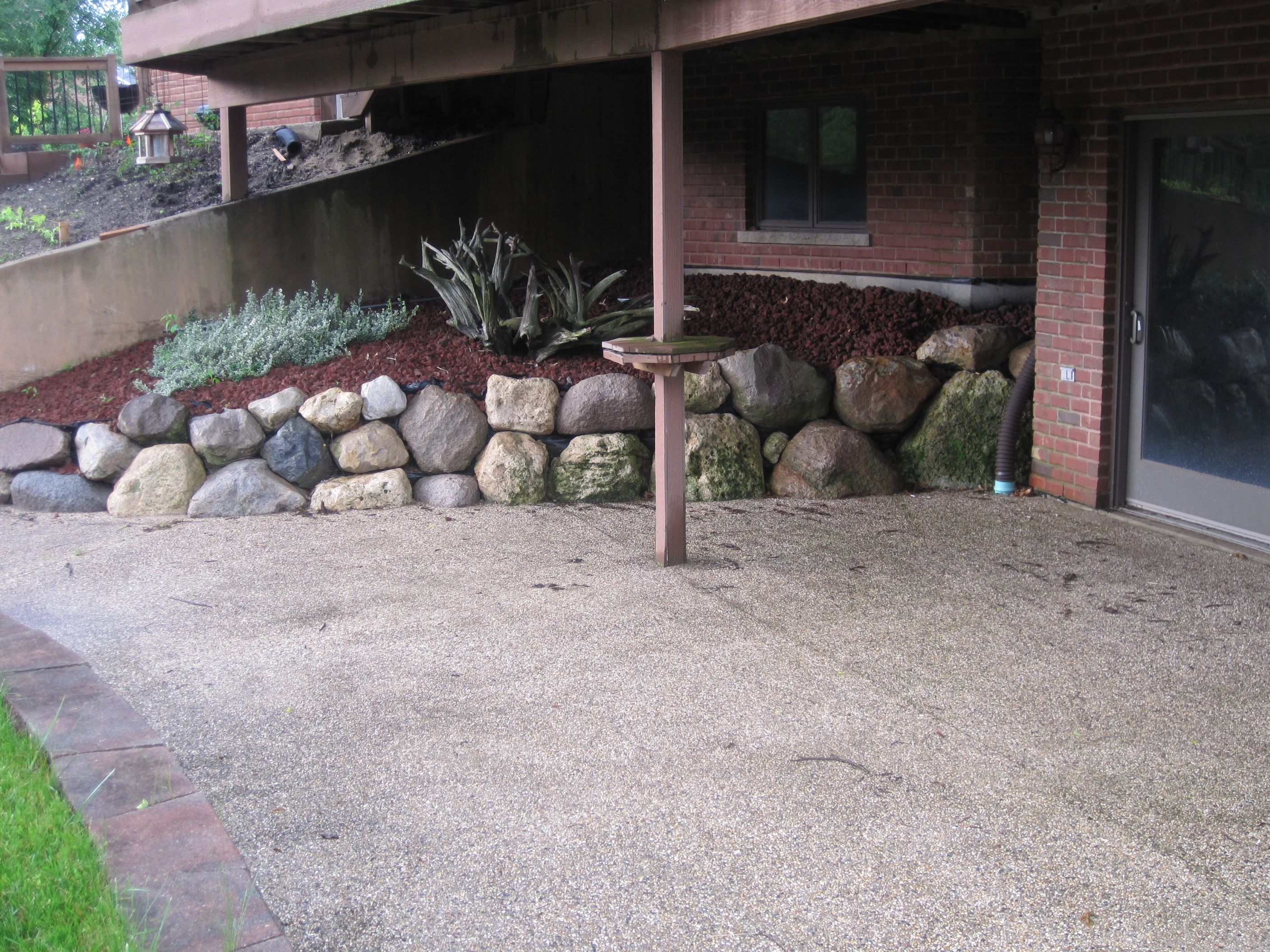 Walk out basement with short wall retaining wall and for Walkout basement patio ideas