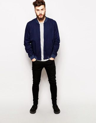 9fcb3159ee25 Wear a deep blue bomber jacket with black slim jeans to create a great  weekend-ready look. Finish off this look with black plimsolls.
