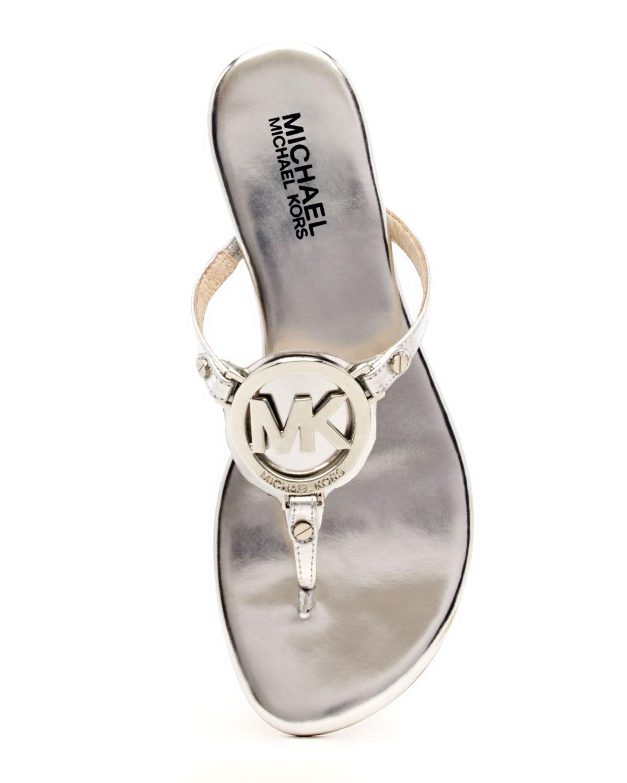 7853488584e MICHAEL Michael Kors Melodie Metallic Logo Thong Sandal in Silver