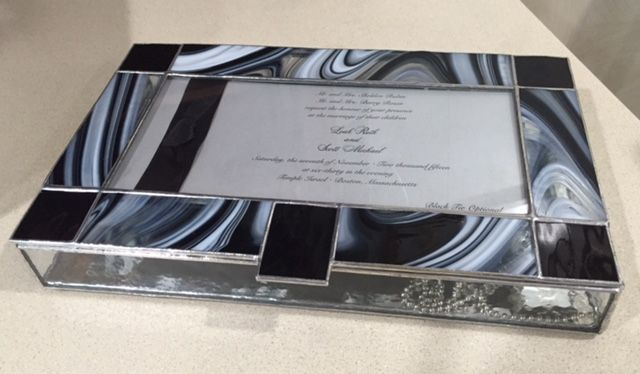 Gorgeous black and white baroque glass really compliments this invitation!