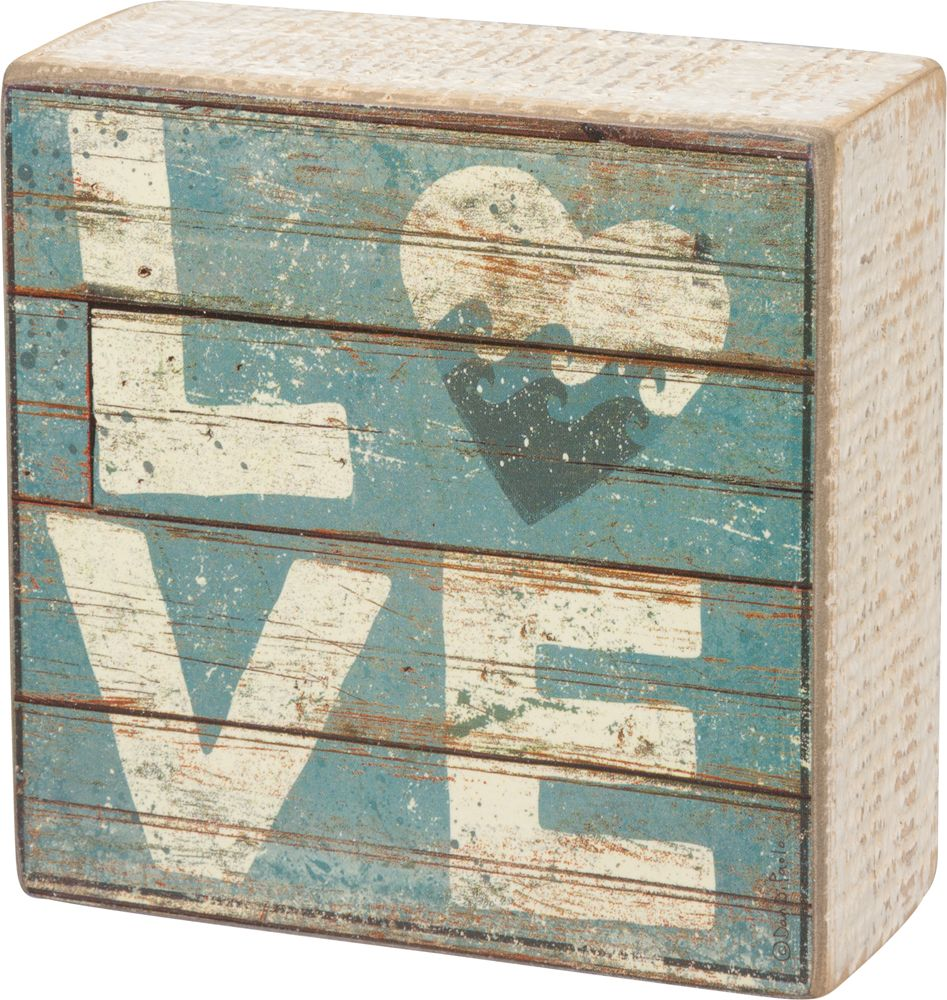 A Slat Wood Box Sign Lending A Distressed Quot Love Quot Sentiment With A Heart Accent As An Quot O Quot With