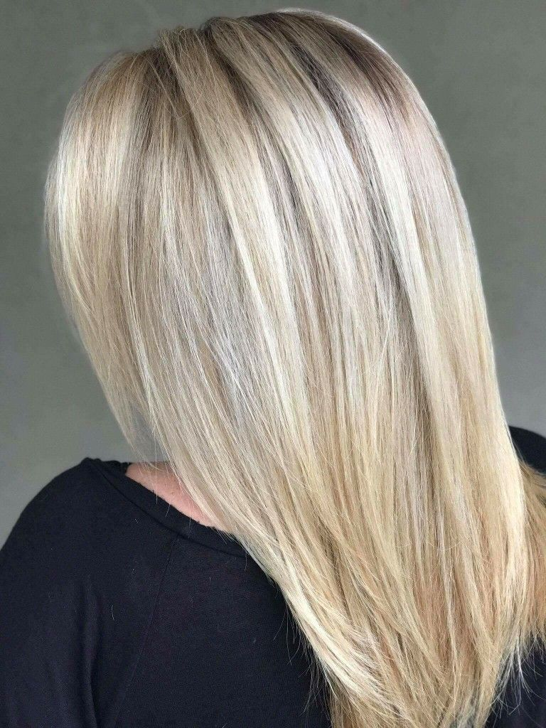 Blonding technique with hand painting at Olivia Lane salon