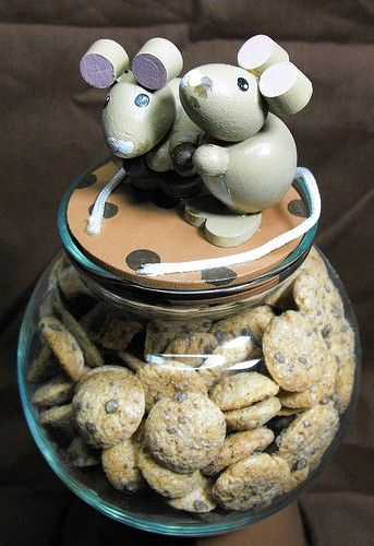 "This dish stands about 9 5/8"" tall X 4"" wide. the lid has 2 adorable handmade mice stealing the chocolate chips for my cookies."