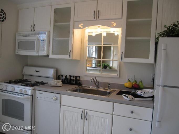Mirror over sink  French Country Kitchen  Kitchen