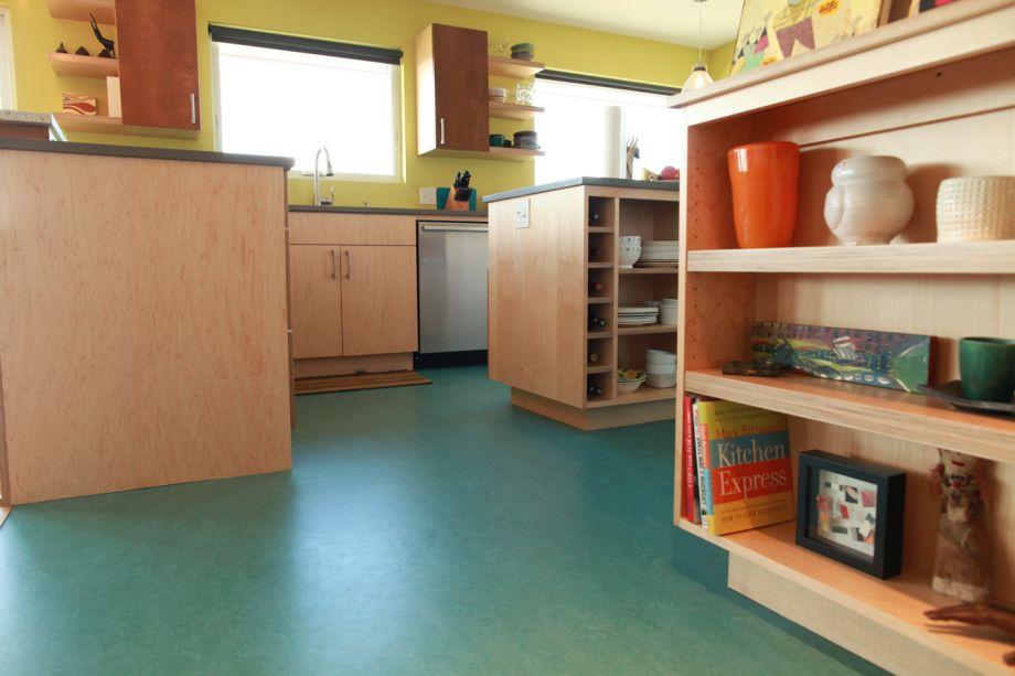 Maple veneer plywood cabinets and vibrant marmoleum floor