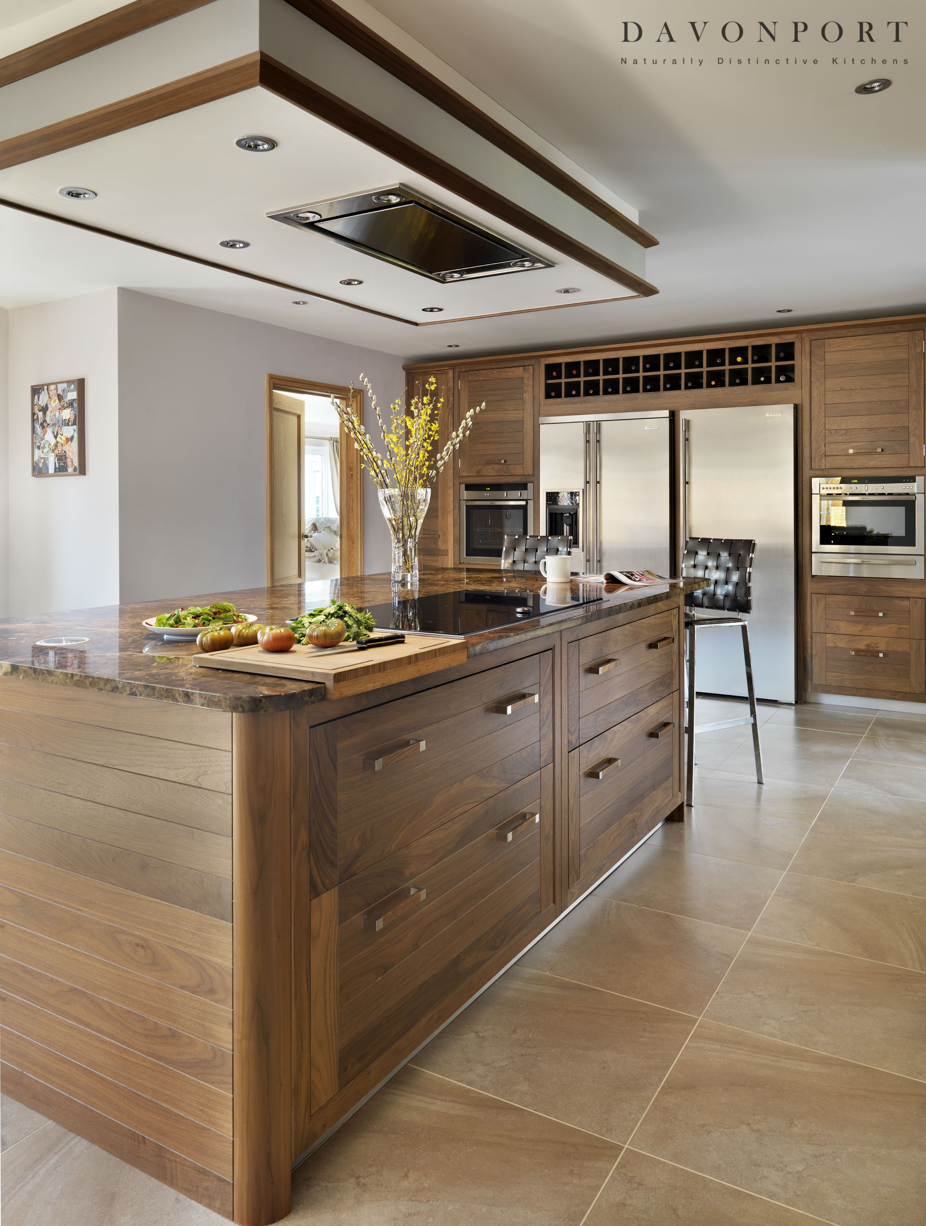 The kitchen island in this design is used as a practical cooking ...