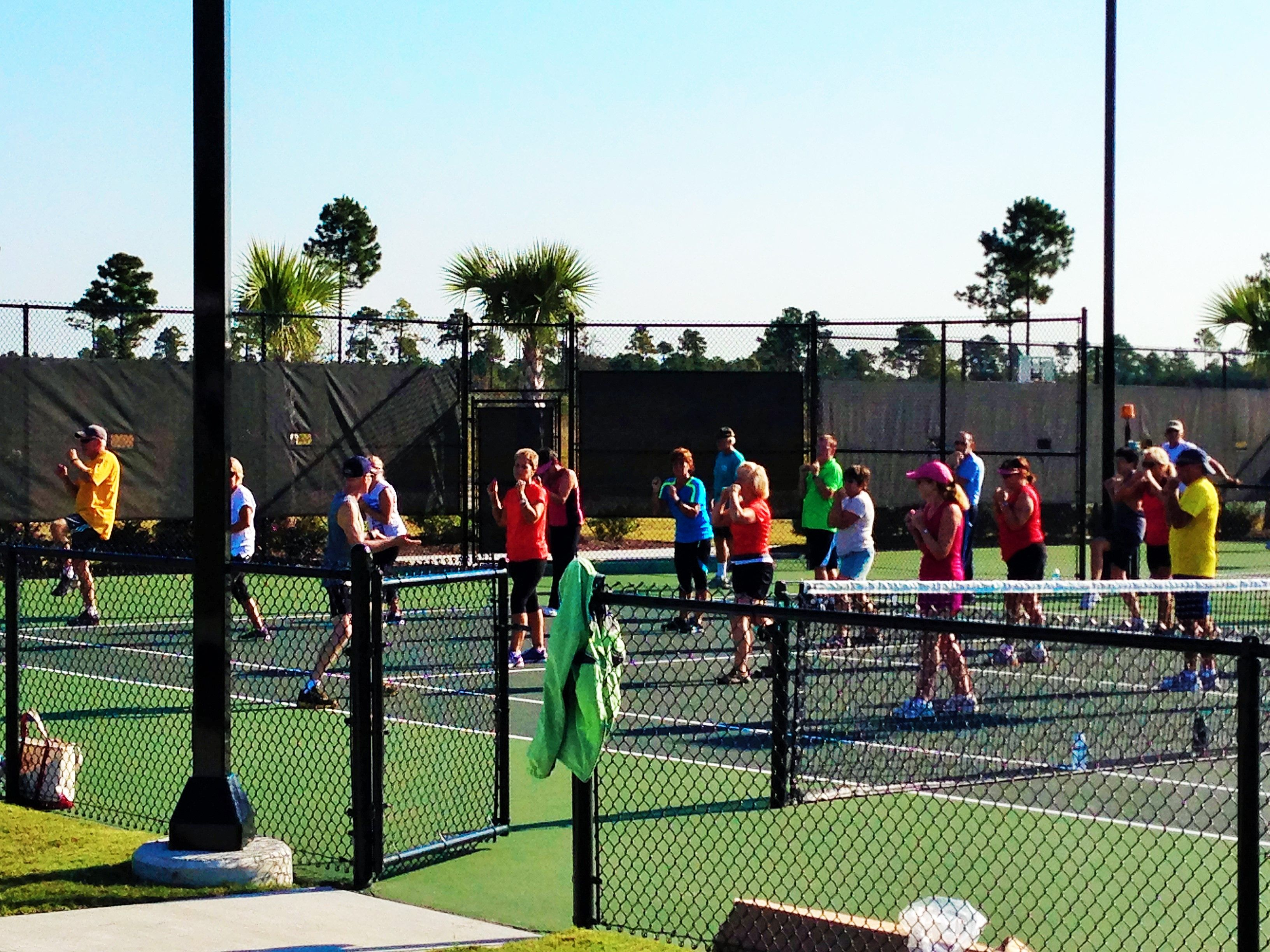 Group exercise on the tennis court CompassPointeNC NC