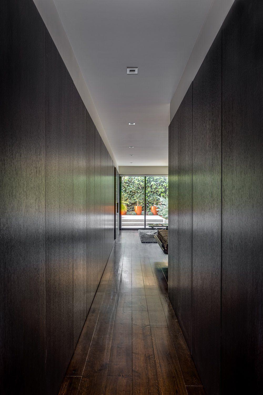 Modern hallway storage ideas  Castro Residence Modern Home in San Francisco California  Dark