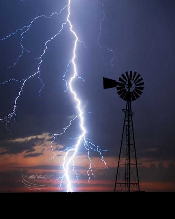 Cloud To Ground Lightening Illuminate A Windmill In SW
