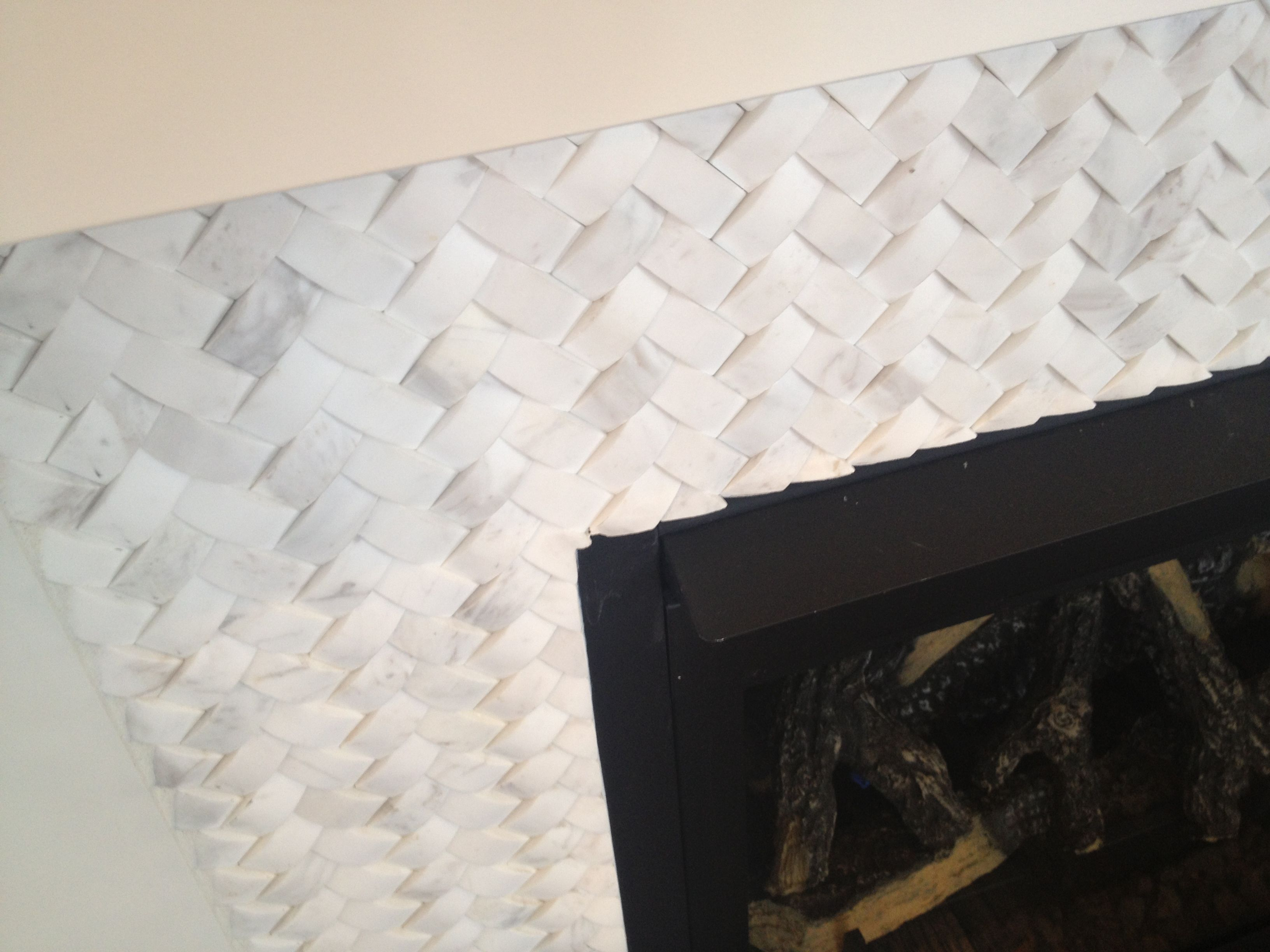 basket weave carrara marble fireplace tile surround with white