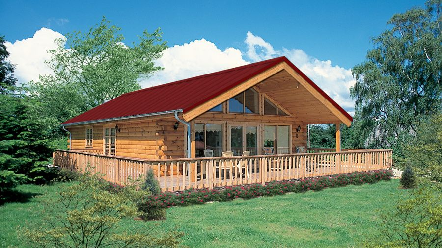 This One Story Log Home Is A Real Winner With The Stellar Wrap Around Deck The Newport Has A Glass Front Too 1196 Log Home Designs Log Cabin Homes Log Homes