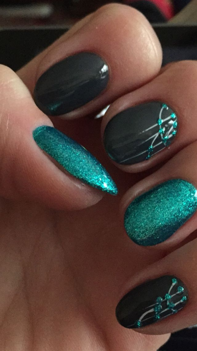 teal glitter and grey nail art