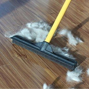 Before Vacuuming Carpets And Rugs Sweep With A Rubber Broom