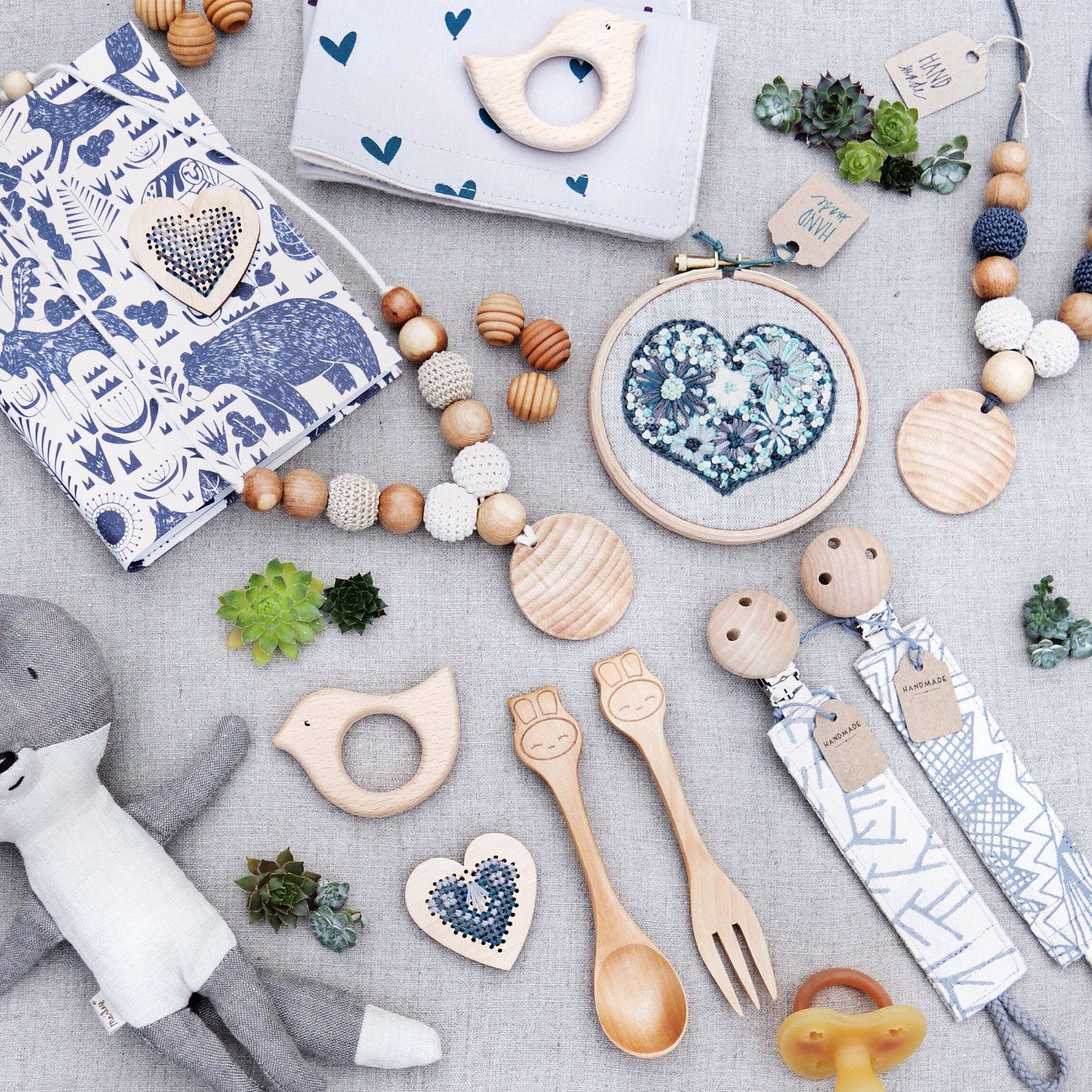 Flatlay of organic Eco baby accessories made with GOT s certified