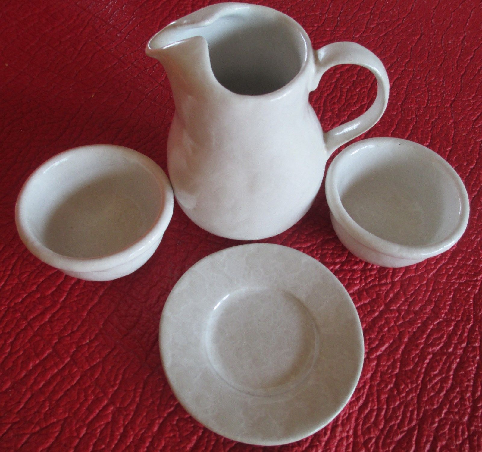 Jug, dishes, and saucer
