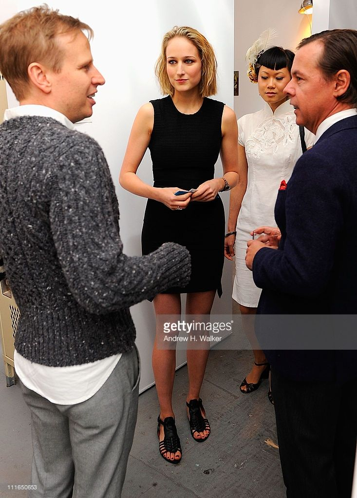 Leelee Sobieski talks with artists at the Tribeca Ball 2011 at the New York Academy of Art on April 4, 2011 in New York City.