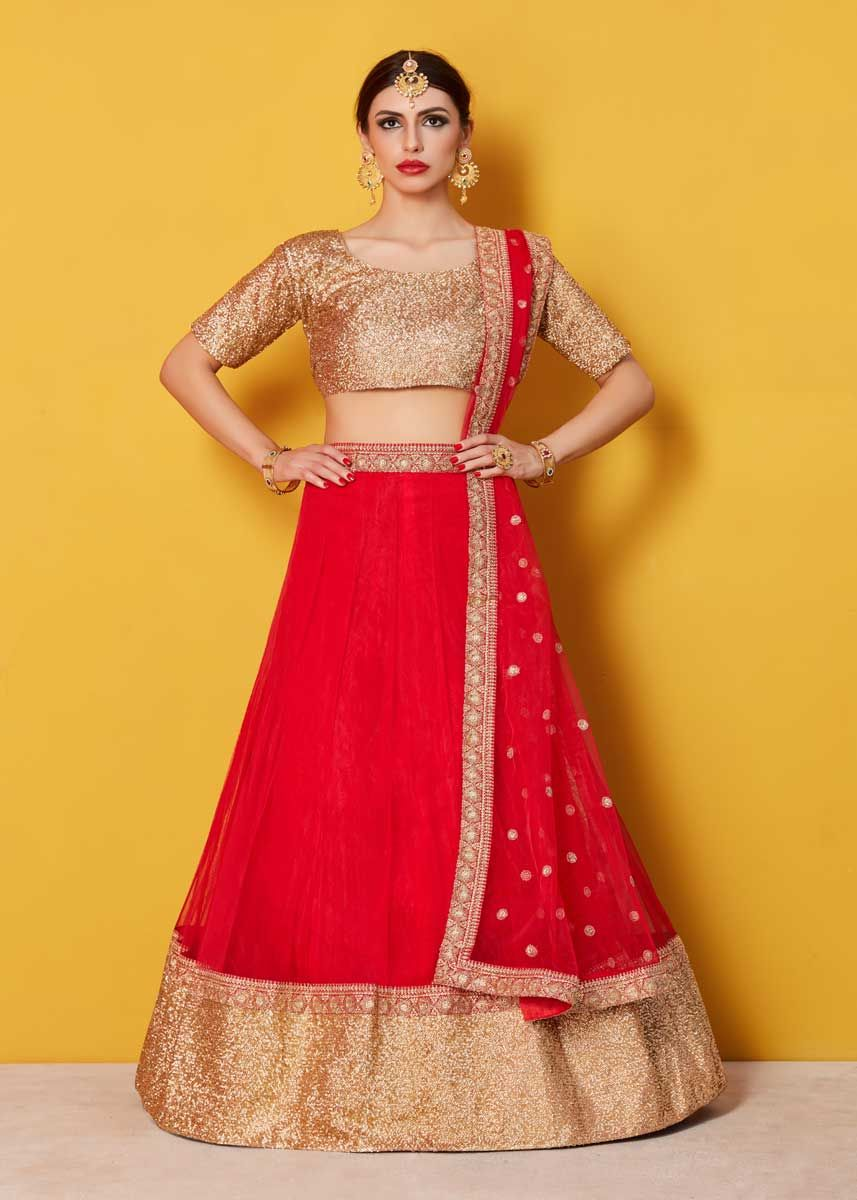 9fdd28ae33 Featuring a scoop neck sequinned glitter blouse and a solid color net  lehenga with a matching red shantoon interlining. The lehenga has a 9″ zari  and sequin ...