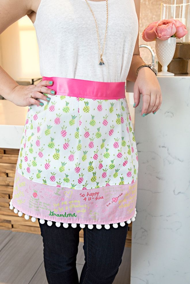 3845edf26a64 Check out this adorable DIY apron that doubles as a bridal shower guest book !