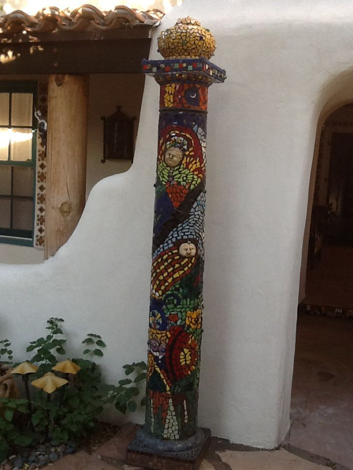 Column with Talavera tile and other pottery, in my courtyard. Mosaic by Jan Wolfe.