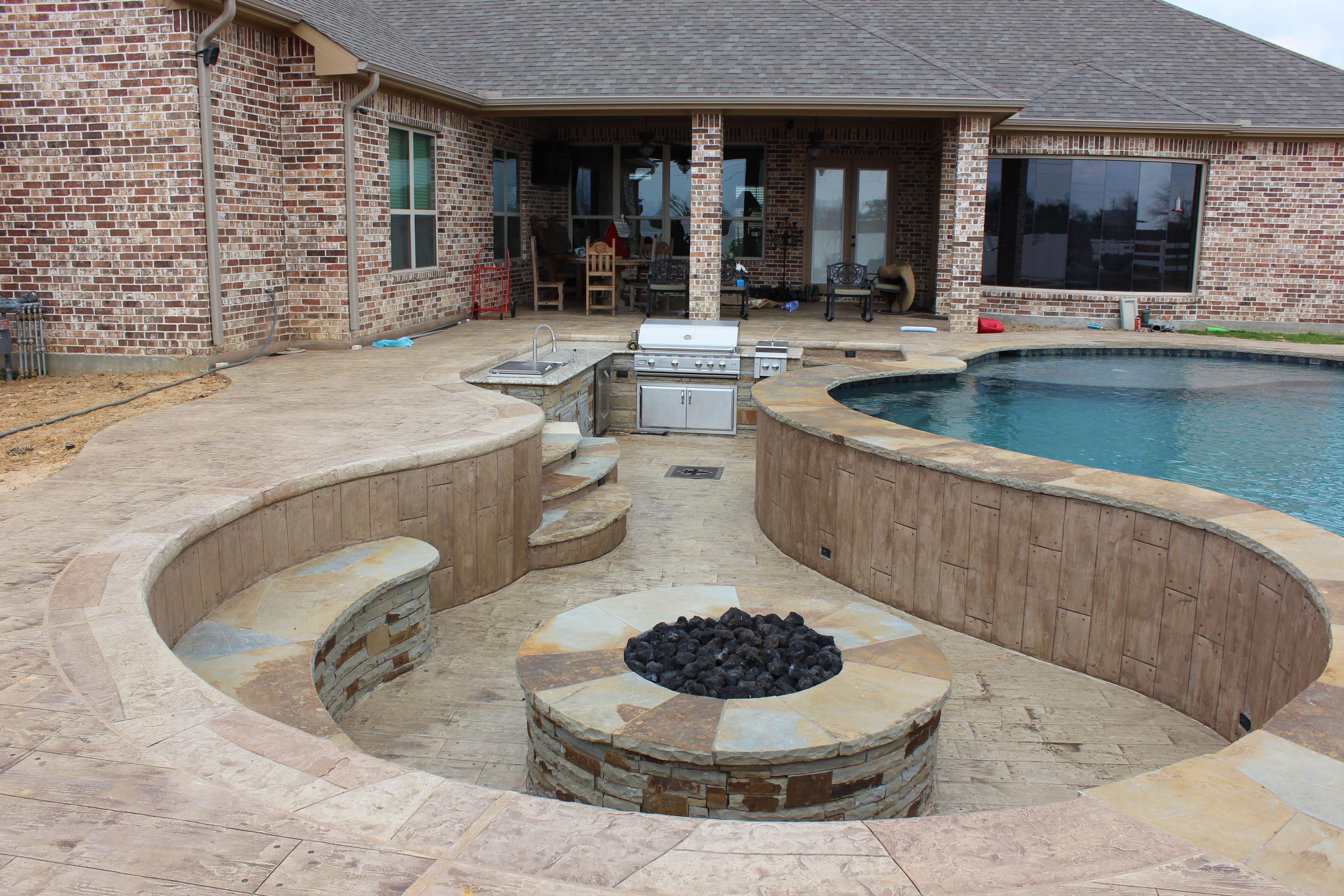 Sunken outdoor kitchen and fire pit with lazy river pool