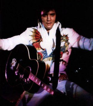"""Elvis also pulled a lot of low stances, including a low square horse stance which he would sink to match the descending note of his bass singer on the """"I Got A Woman/Amen"""" medley that followed """"See See Rider"""" for the last few years."""