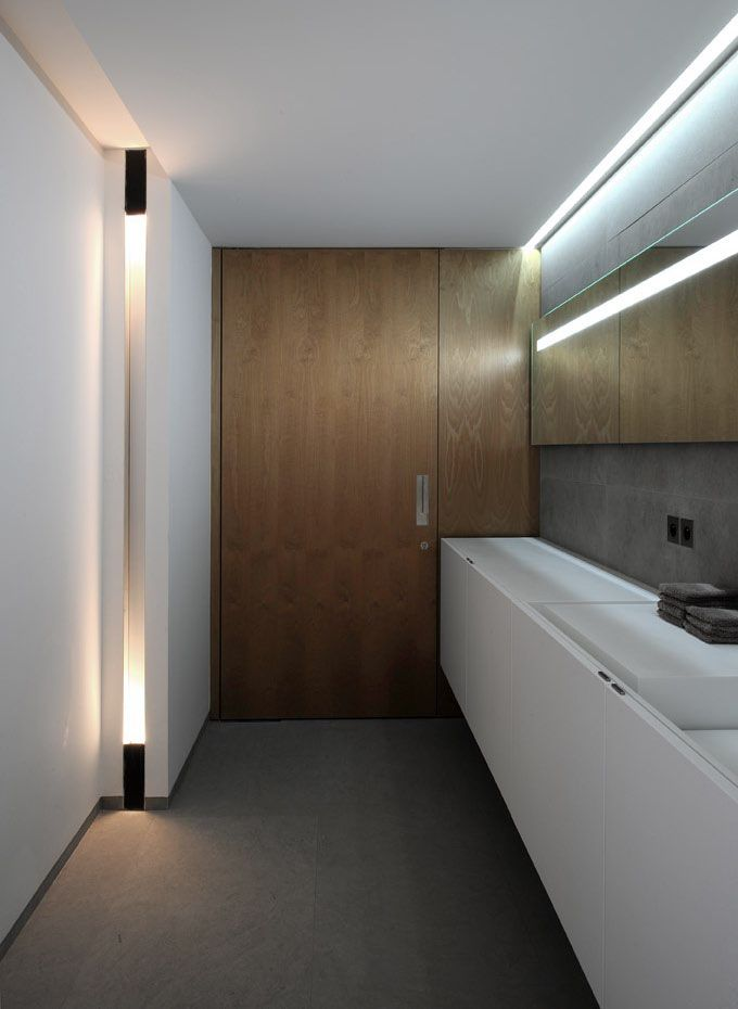 Minimalist white bathroom with wood accent zone extra for Bathroom zone 3