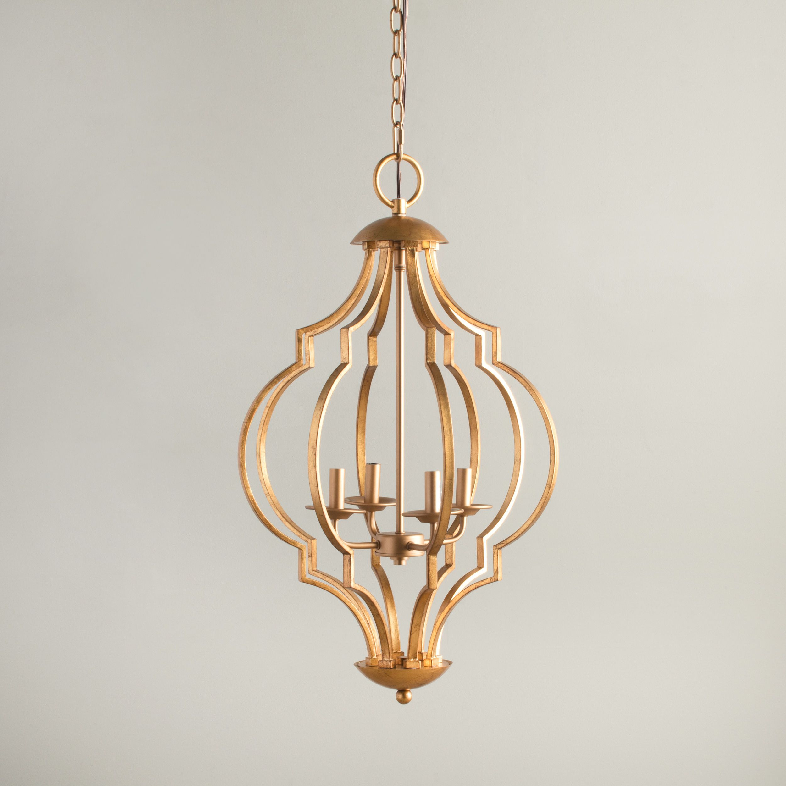 Resemblant of a fine open and airy bird cage this gold leaf this gold leaf chandelier features a metal frame curved into a distinctive and unique pattern that is sure to please this four light chandelier uses four arubaitofo Images