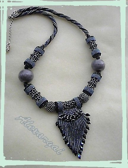 Collier_Fringed_caged_bead1  I love this the shape is neat and size is just right!