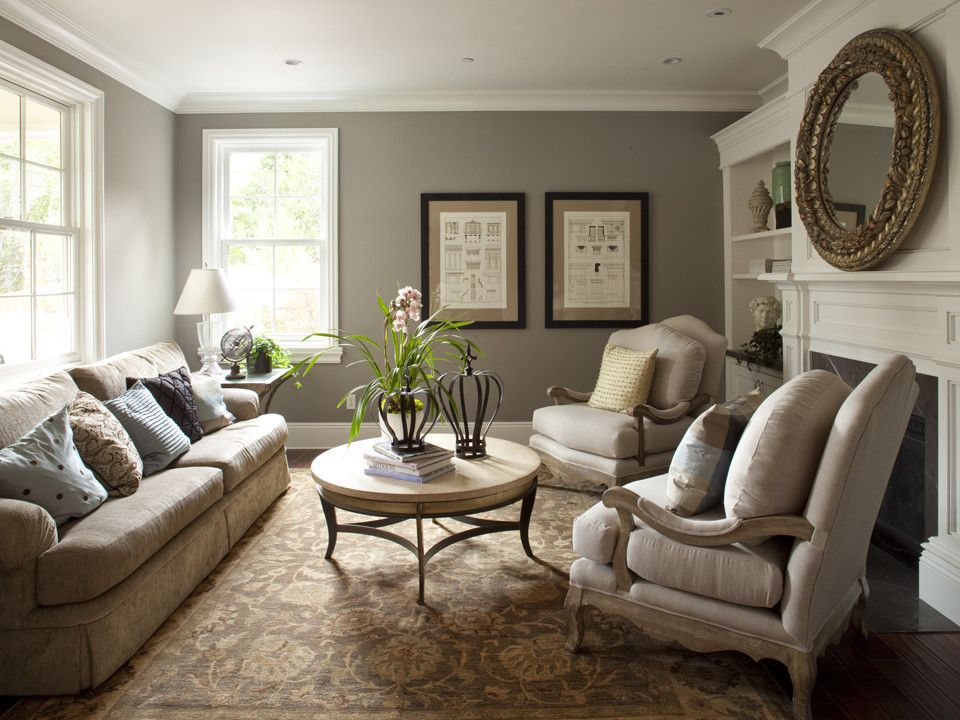 grey-blue living room, tan creme furniture, white trim, gold