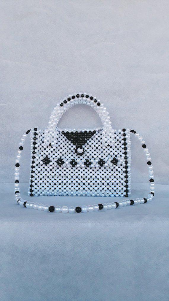 A handmade women handbag made with pearl beads