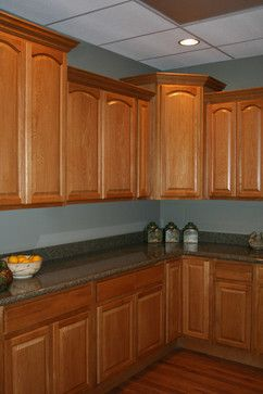 Oak Cabinets Dark Counters Wood Floors Traditional