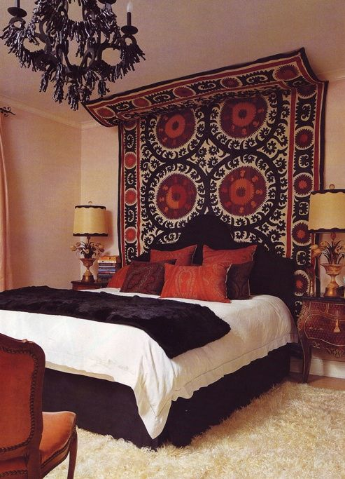 Exotic bedroom - love the Moorish (?) rug that goes up the wall and onto  the ceiling. You get a bold headboard and wall decor / art all in one.