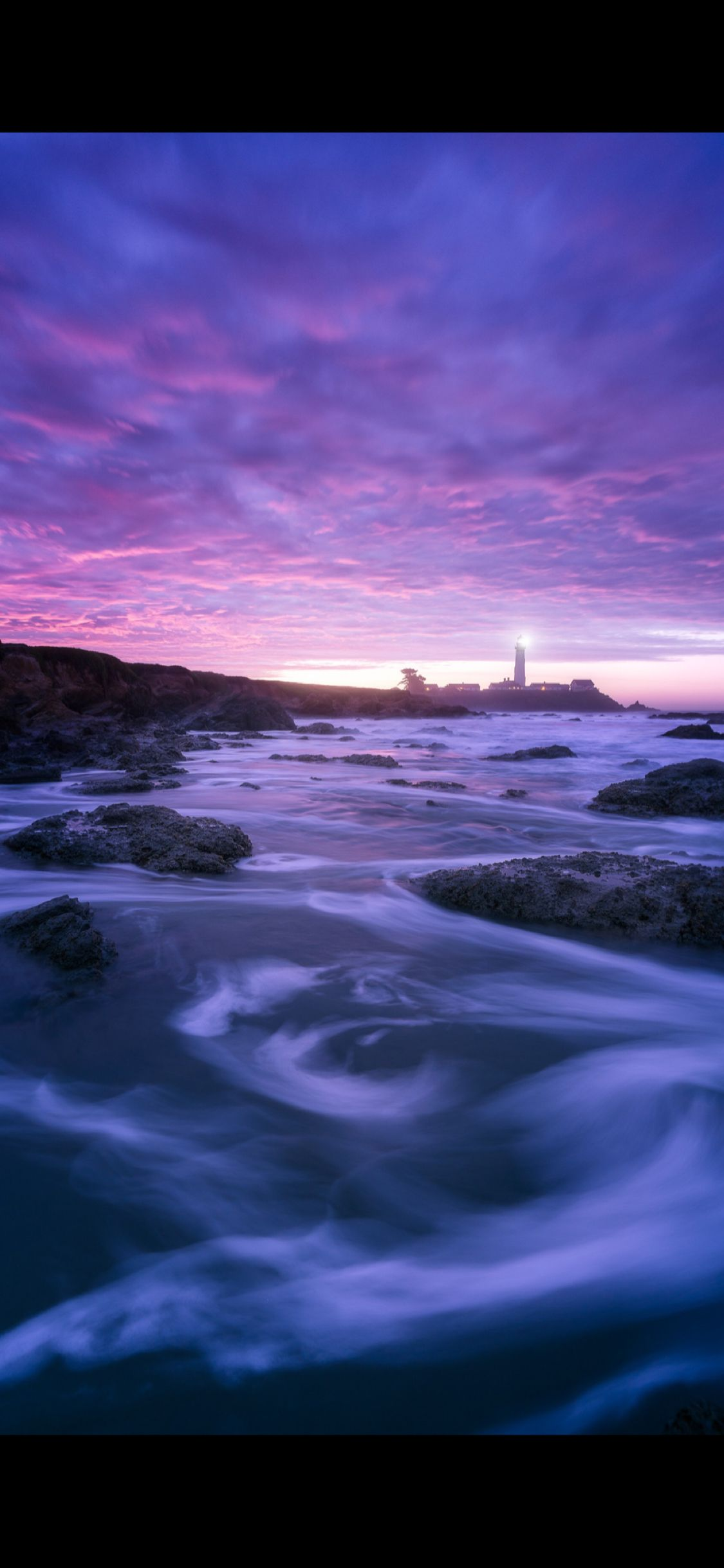 The lighthouse in the purple Ios wallpapers, Iphone