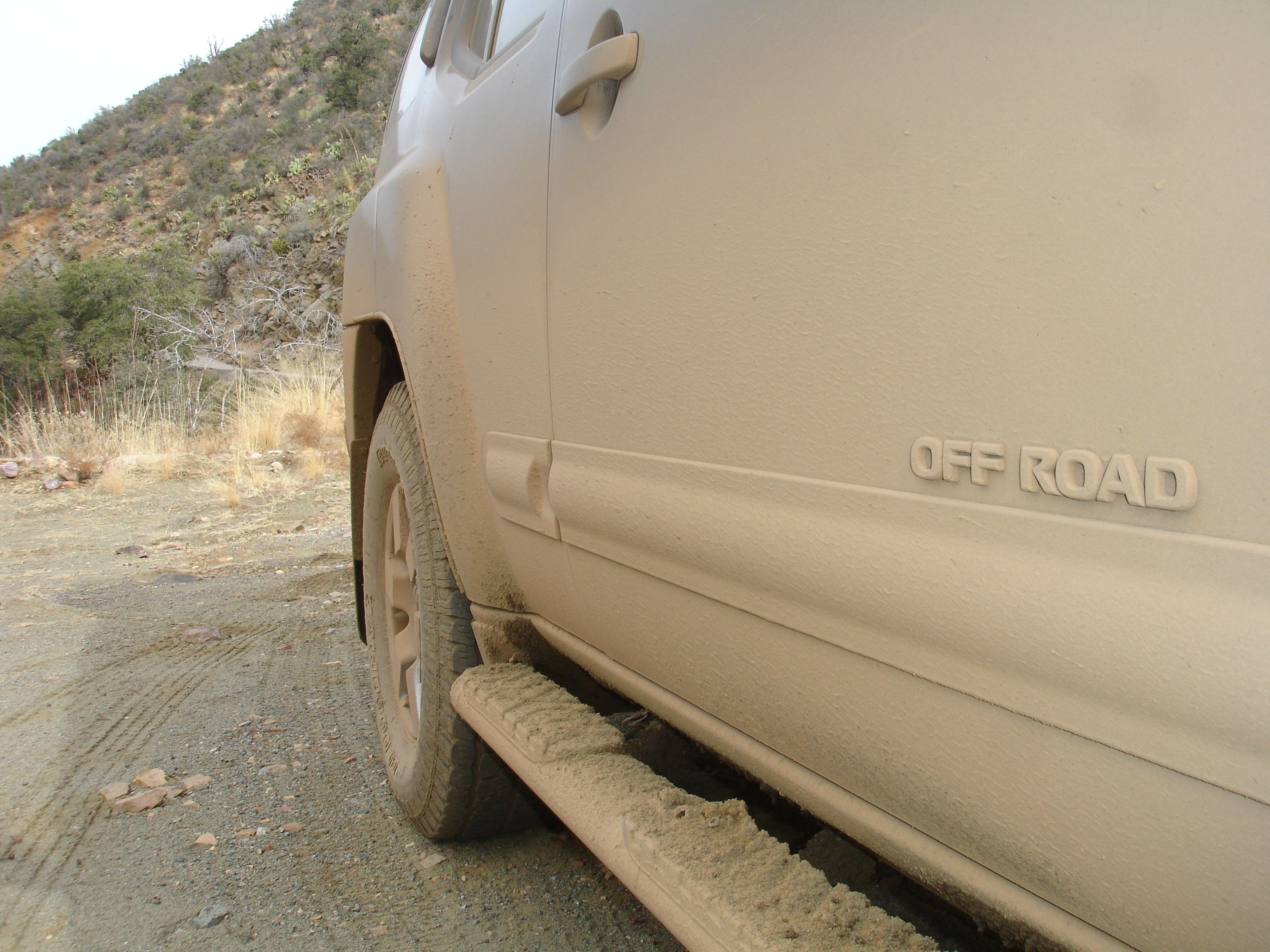 Off road in Arizona - photo of black Nissan Xterra by Catherina Severin