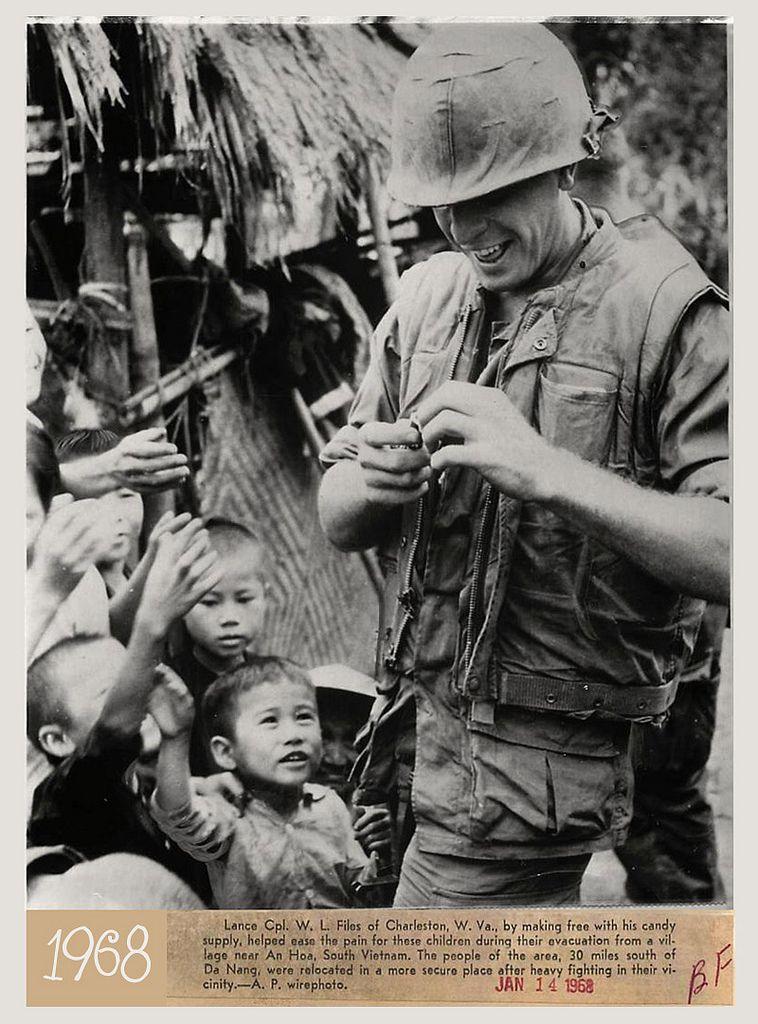 https://flic.kr/p/dDzM7K | 1968 U.S. Soldier Gives Candy to Village Children near An Hoa