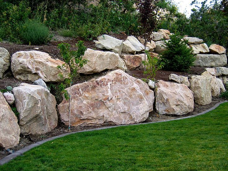 Boulder Retaining Wall Offers The Experience Of 200 000 Square Feet Of Rock Retaini Landscaping With Boulders Rock Wall Landscape Landscaping Retaining Walls