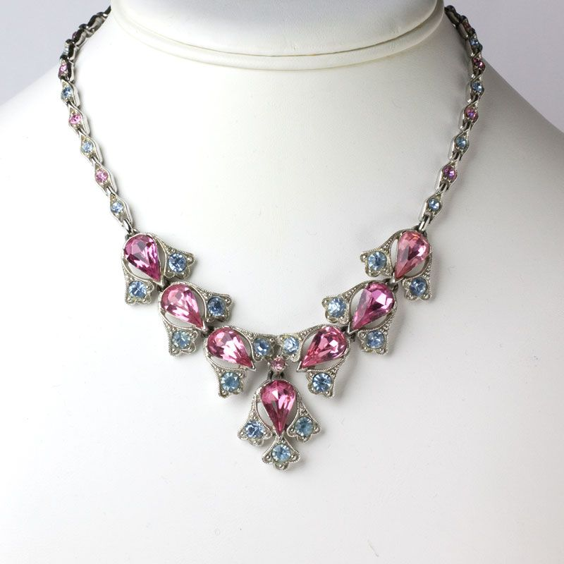 A striking combination of pink tourmaline and alexandrite glass stones form this 1950s necklace by Bogoff.