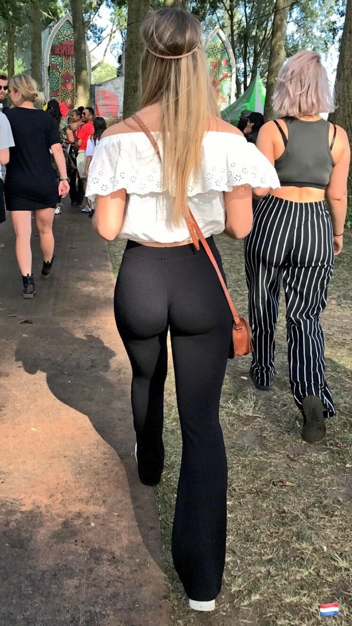 sexy hippy chick with a perfect ass wearing tight black leggings