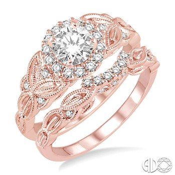 Bob Richards Jewelers: 3/4 Ctw Diamond Wedding Set with 5/8 Ctw Round Cut Engagement Ring and 1/10 Ctw Wedding Band in 14k Pink Gold  $2,825.00