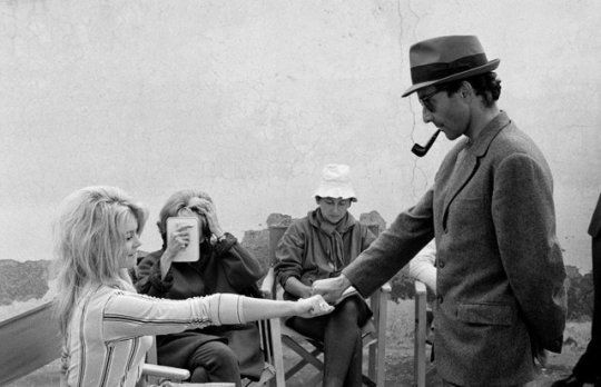 Brigitte Bardot plays a guessing game with director Jean-Luc Godard on the set of Contempt (Le Mépris), 1962.